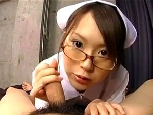 Yuri Kousaka kneels before dick to work it with her tits
