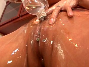 A lot of oil for a girl anally fucked