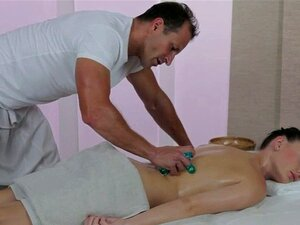 Masseur licks and fucks hot brunette on massage table. Masseur George with strong hands massages and oils gorgeous body of brunette Lucy then she sucks his stiff dick and he licks and fucks her pussy on massage table